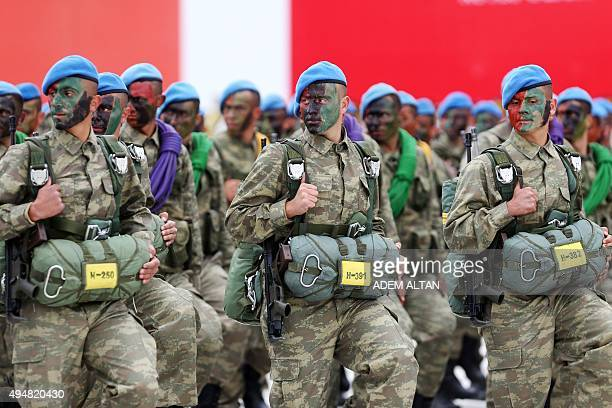 Soldiers march during a parade as part of a ceremony marking the 92nd anniversary of Republic Day at the Ataturk Cultural Center on October 29 2015...