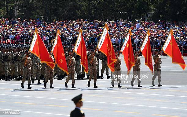 Soldiers march in a military parade in Tiananmen Square in Beijing on September 3 to mark the 70th anniversary of victory over Japan and the end of...