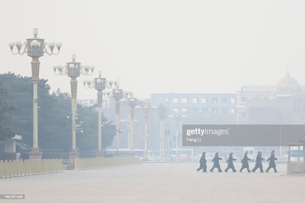 Soldiers march on the Tiananmen Square before the fifth plenary meeting of the National People's Congress during severe pollution on March 15, 2013 in Beijing, China. Li Keqiang was elected as China's Premier Friday at the 12th National People's Congress, the country's top legislature.