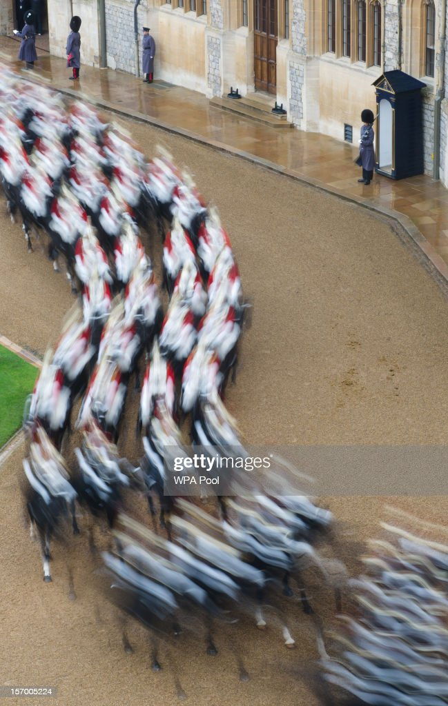 Soldiers march out of the central courtyard after being presented to Amir Sheikh Sabah Al-Ahmad Al-Jaber Al-Sabah of Kuwait on his arrival at Windsor Castle during a three-day state visit on November 27, 2012 in Windsor, England. In the afternoon a military parade will be inspected at Royal Military Academy Sandhurst then a banquet is to be held at Windsor Castle in the Amir's honour this evening.
