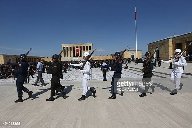 Soldiers march to change guard as some 6000 people gather to form a large portrait of Mustafa Kemal Ataturk the founder of modern Turkey at his...