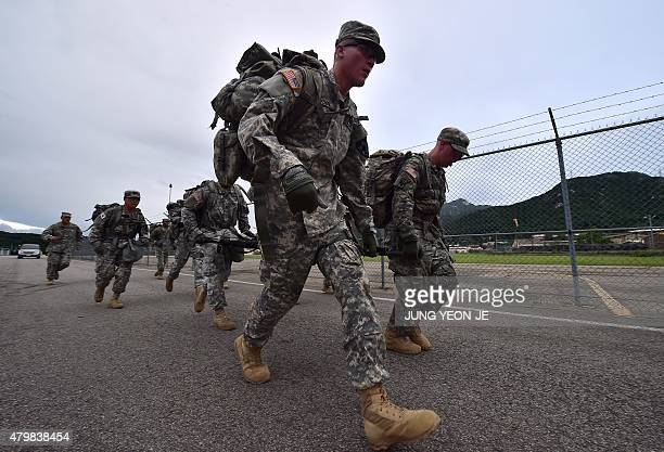 US soldiers march with full packs during a competition to test individual skills at a US Army base in Uijeongbu north of Seoul on July 8 2015 The...