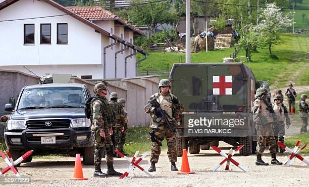 S soldiers members of NATO mission in Bosnia surround the house of the wife of Bosnian Serb wartime leader and most wanted war crime suspect Radovan...