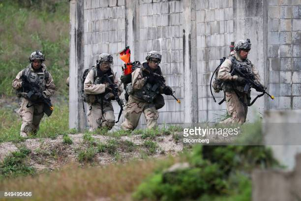 US soldiers mobilize during Warrior Strike VIII a bilateral training exercise between the US Army's 2nd Armored Brigade Combat Team 1st Cavalry...