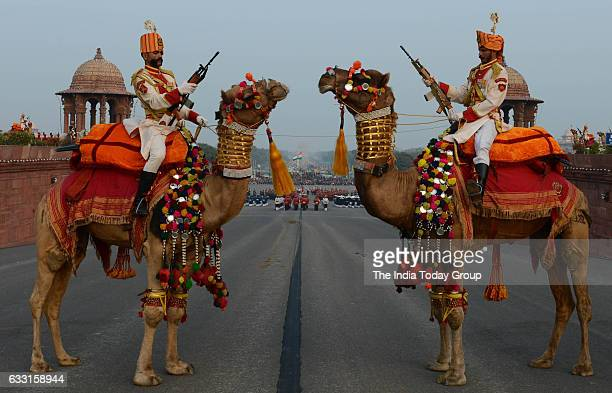 BSF soldiers mounted on camels participate in full dress rehearsal for the Beating Retreat ceremony in New Delhi