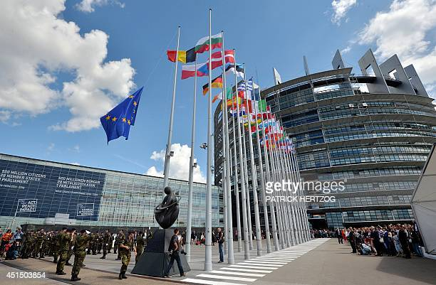 Soldiers of a Eurocorps detachment raise the European Union flag to mark the inaugural European Parliament session on June 30 in front of the...