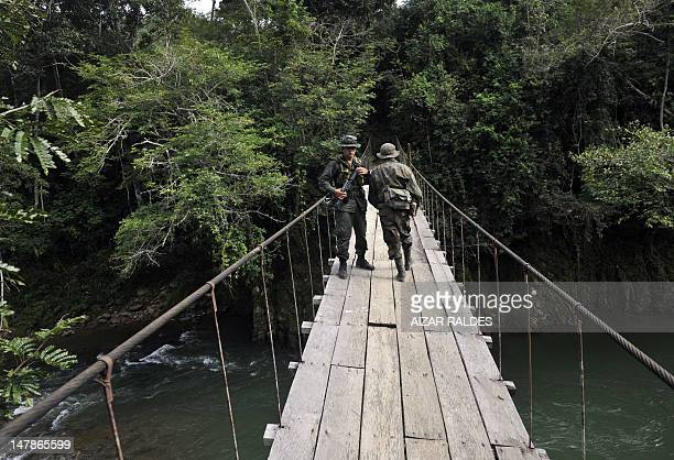 Soldiers of Bolivia's Joint Task Force cross a hanging bridge as they walk through the jungle in search of coca plantations in Caranavi a locality...