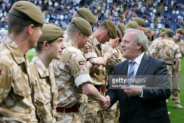 Soldiers of Burma Company 1st Battalion of the Duke of Lancaster's Regiment are presented with medals recognising recent service in Iraq by Gordon...