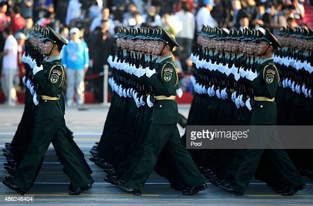 Soldiers of China's People Liberation Army prepare in front of the Tiananmen Gate ahead of the military parade to mark the 70th Anniversary of the...