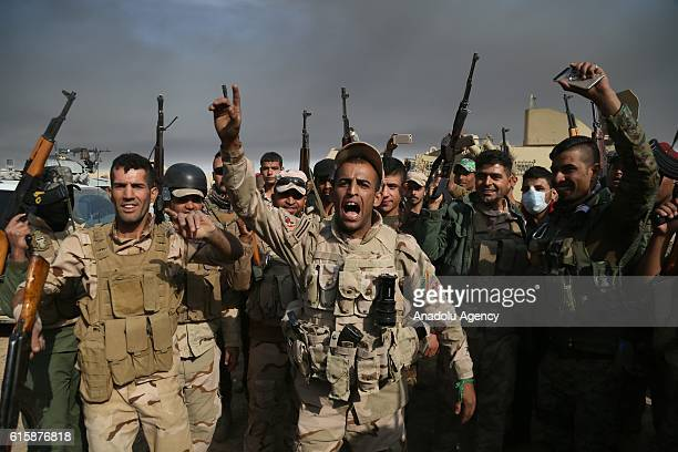 Soldiers of Iraqi Army shout slogans as they move forward Khalid Saleh and Zanawer Villages from recaptured village Kabarok of Qayyarah Town to...
