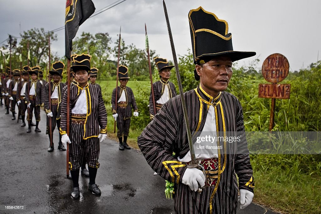 Soldiers of Kraton Palace parade during the Cembengan ritual 'Manten Tebu' on April 6, 2013 in Yogyakarta, Indonesia. The Cembengan ritual, performed to bring about a good season's sugarcane crop, is held annually before the milling and processing season starts in Indonesian sugar mills.