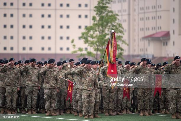 US soldiers of the 1st Armoured Brigade Combat Team 1st Infantry Division salute during a transfer of authority ceremony at Camp Humphreys in...