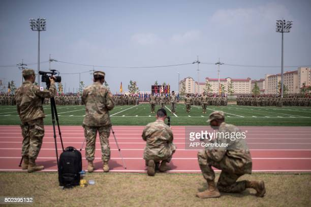 US soldiers of the 1st Armoured Brigade Combat Team 1st Infantry Division take part in a transfer of authority ceremony at Camp Humphreys in...