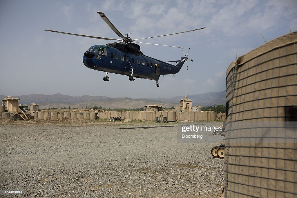 Soldiers of the 2-506th Infantry Battalion of the 4th Brigade of the 101st Airborne Division sit aboard a contractor helicopter at COP Sabari in Khost province, Afghanistan, on Tuesday, July 2, 2013. U.S. President Barack Obama has maintained his position of ending U.S. combat in Afghanistan by the end of next year, though that plan has included keeping in place several thousand troops for support. Photographer: Victor J. Blue/Bloomberg via Getty Images