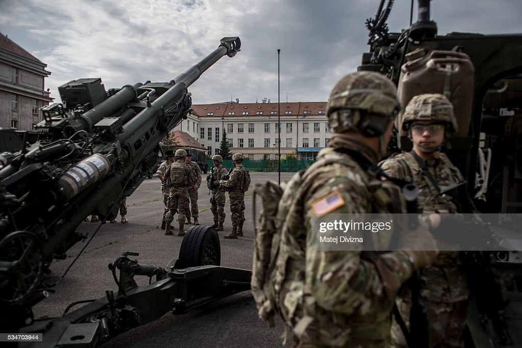 U.S. soldiers of the 2nd Cavalry Regiment of the US Army chat as they arrived at Czech army barracks on May 27, 2016 in Prague, Czech Republic. About 420 U.S. soldiers with 225 army vehicles are travelling in the 'Dragoon Ride II' convoy from Germany to Estonia where they will participate in the Saber Strike 16 exercise in the Baltic region. With this exercise, NATO shows cohesiveness and readiness of the involved countries to collective defense and future operations in Europe.