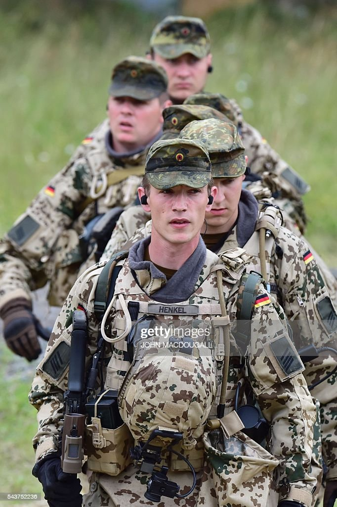 Soldiers of the 33rd Panzergrenadier bataillon carry a wounded comrade during a drill at their headquarters in Neustadt am Ruebenberge on June 29...