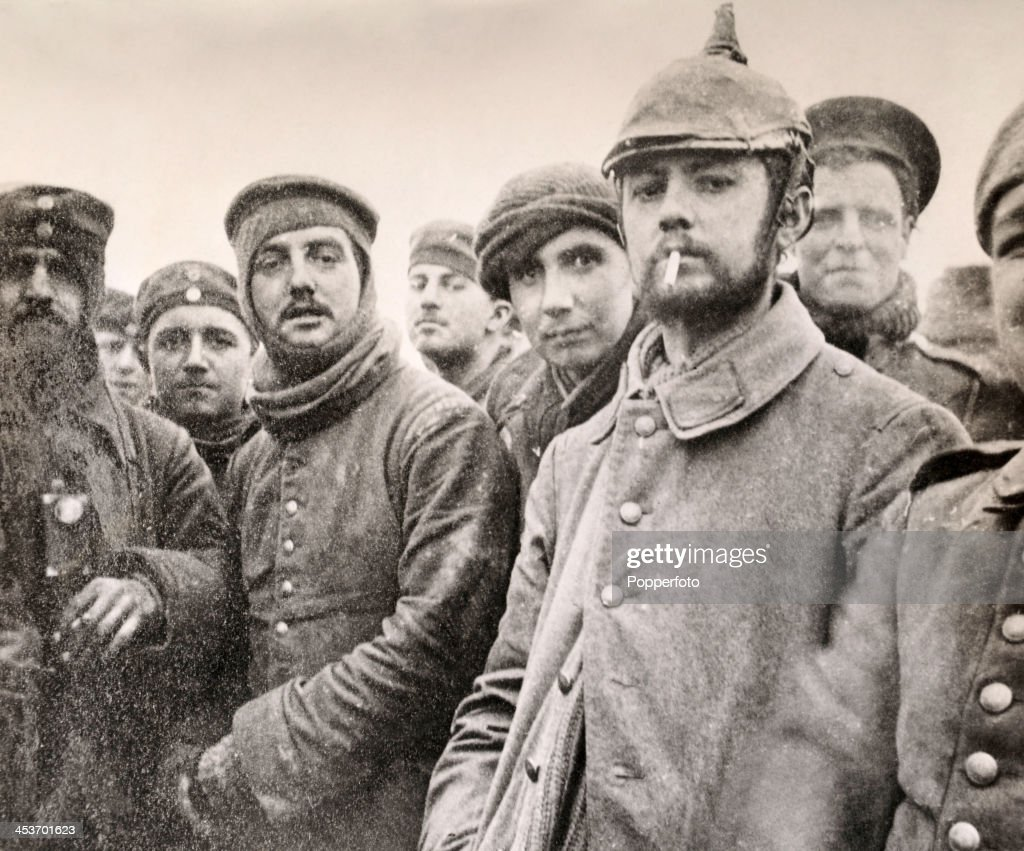 Soldiers of the 5th London Rifle Brigade with German Saxon regimental troops at Ploegsteert Wood during the Christmas Truce of World War One December...