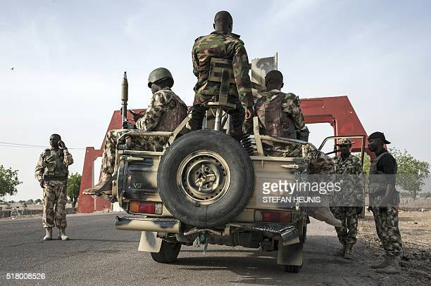 Soldiers of the 7th Division of the Nigerian Army prepare to leave Maiduguri in a heavily armed convoy on the road to Damboa in Borno State northeast...