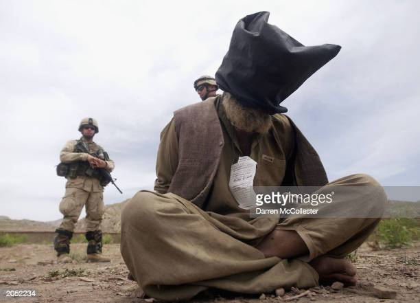 S soldiers of the 82nd Airborne watch over Afghan prisoners during Operation Dragon Fury June 2 2003 in eastern Afghanistan The objective of the...