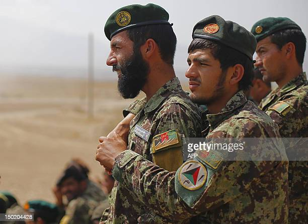 Soldiers of the Afghan National Army watch trainings and tactical manoeuvres operated by French Army's mentors members of the 'Epidote' unit at Camp...
