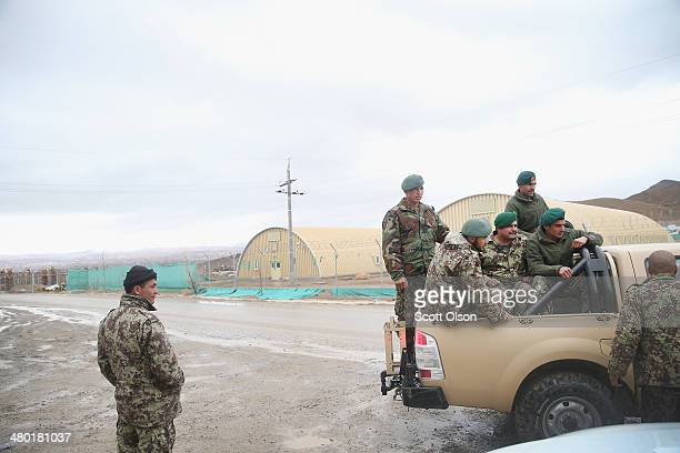 Soldiers of the Afghan National Army's 203rd Corps Engineering Kandak head home after being released following a day of classes at Forward Operating...