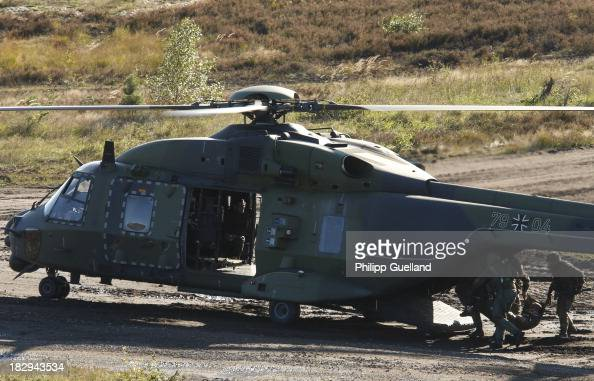 Soldiers of the Bundeswehr demonstrate an air medevac procedure during the annual military exercises held for the media at the Bergen military...