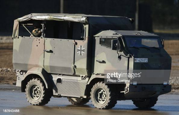Soldiers of the Bundeswehr present a mungo armoured tranport vehicle during the annual military exercises held for the media at the Bergen military...