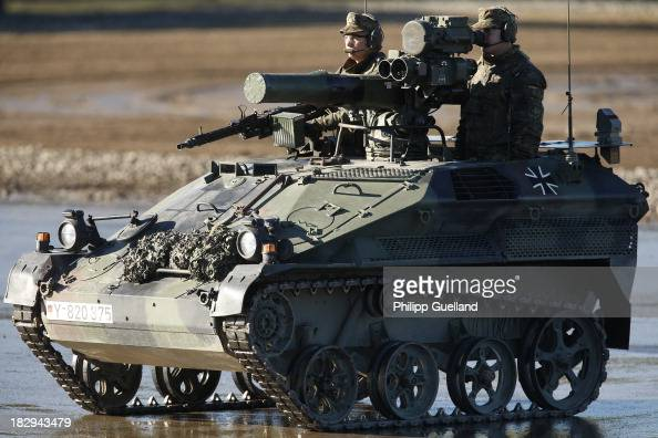 Soldiers of the Bundeswehr present a Wiesel small tank for airborne troops during the annual military exercises held for the media at the Bergen...