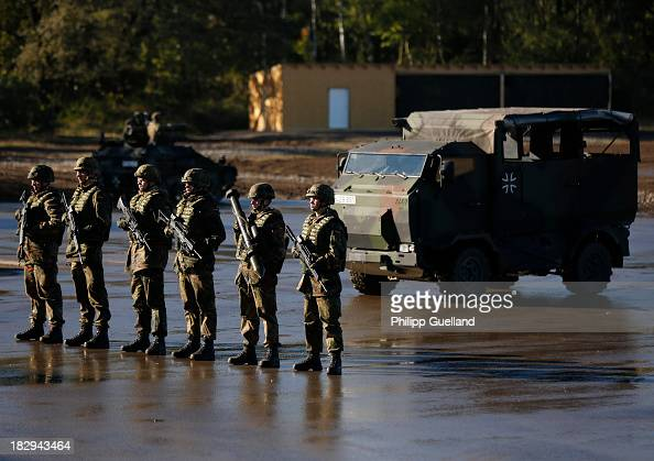 Soldiers of the Bundeswehr present their weapons during the annual military exercises held for the media at the Bergen military training grounds on...