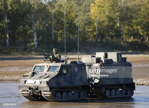 Soldiers of the Bundeswehr show a Haegglunds BV 206 troop transporter during the annual military exercises held for the media at the Bergen military...