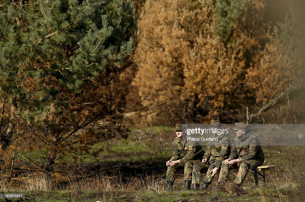Soldiers of the Bundeswehr take a break during the annual military exercises held for the media at the Bergen military training grounds on October 2, 2013 near Munster, Germany. The Bundeswehr is transitioning to a professional army as Germany recently ended mandatory military service.
