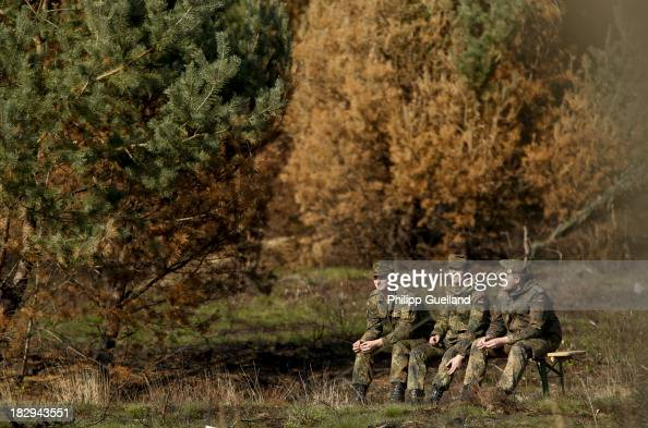 Soldiers of the Bundeswehr take a break during the annual military exercises held for the media at the Bergen military training grounds on October 2...
