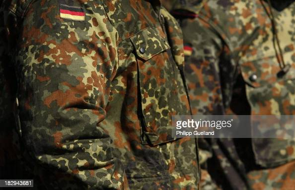Soldiers of the Bundeswehr wear fatigues in Flecktarn camouflage pattern are seen during the annual military exercises held for the media at the...