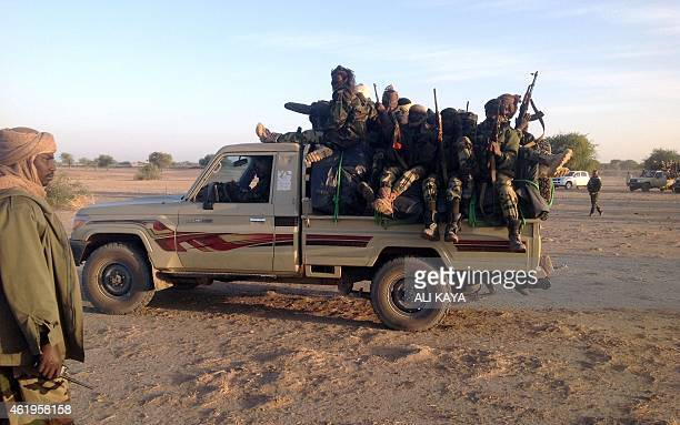 Soldiers of the Chadian army patrol on January 21 at the border between Nigeria and Cameroon some 40 km from Maltam as part of a military contingent...