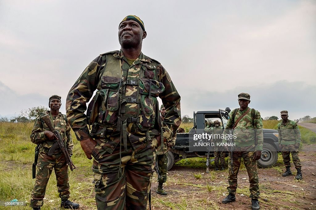 Soldiers of the Democratic Republic of Congo regular army patrol in Kimbumba 5kms from the border with Rwanda on June 13 2014 Rwandan and Congolese...