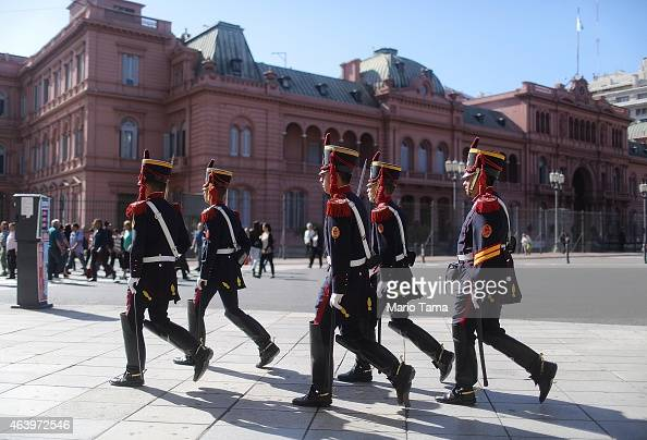 Soldiers of the elite Grenadier Regiment march towards the Casa Rosada presidential palace after the changing of the guard ceremony on February 20...