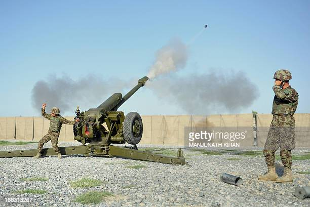 Soldiers of the Field Artillery Division of the Afghan National Army fire a D30 122mm Howitzer gun during a training session of ANA soldiers at the...