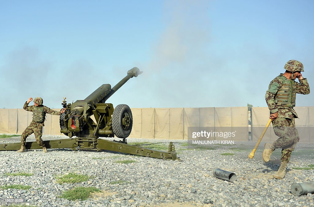Soldiers of the Field Artillery Division of the Afghan National Army (ANA) fire a D30, 122mm Howitzer gun during a training session of ANA soldiers at the US Shinwar Forward Base in the province of Nangarhar on April 11, 2013. The US Field Artillery Battery of 4th Kandak is training Afghan soldiers in using artillery to support their Afghan National Army. AFP PHOTO / MANJUNATH KIRAN
