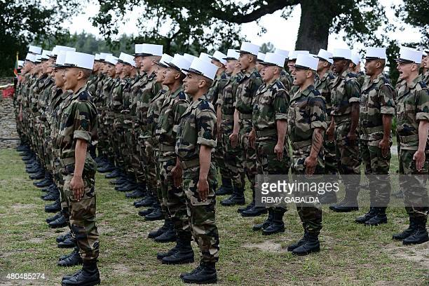 Soldiers of the French Foreign Legion stand at attention on June 16 2015 while receiving their White Kepi during a ceremony at 'The Farm' a training...