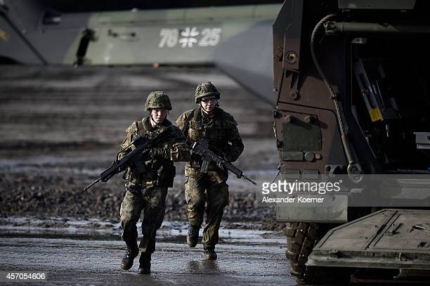 Soldiers of the German Armed Forces show their skills prior the arrival of German Defense Minister Ursula von der Leyen in land operation exercises...