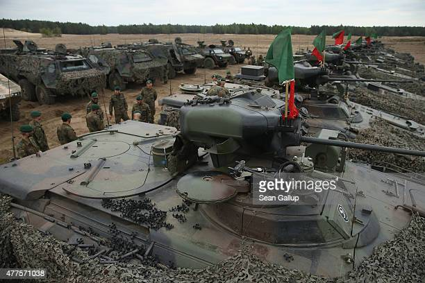 Soldiers of the German armed forces the Bundeswehr stand among their Marder light tanks during the NATO Noble Jump military exercises of the VJTF...