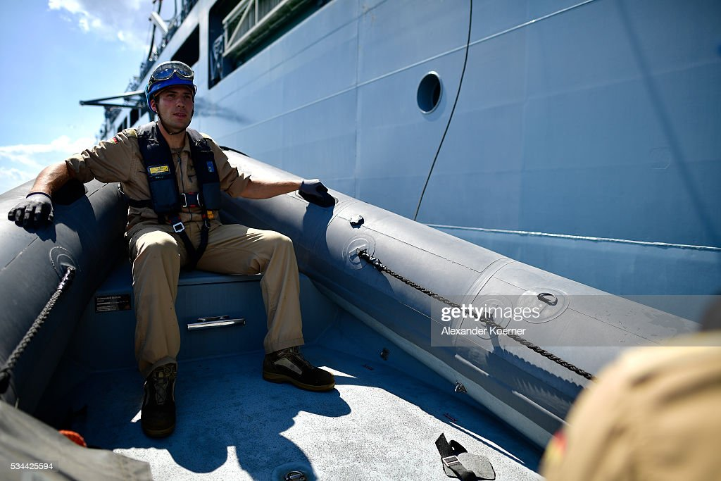 Soldiers of the German navy unload a speed boat from the German combat support ship 'Bonn' at the bay of Izmir on May 26, 2016 in Izmir, Turkey. NATO's Standing Maritime Group 2 is currently deployed in the region between the mainland of Greece and Turkey, and will conduct surveillance and monitor illegal crossings in the Aegean Sea. The number of attempts by refugees to reach the islands of Greece has dropped rapidly.