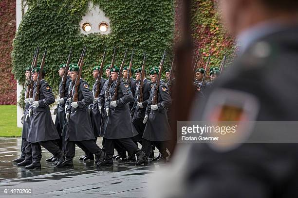Soldiers of the guard batallion get in position for military honours at the Federal Chancellery on October 12 2016 in Berlin Germany