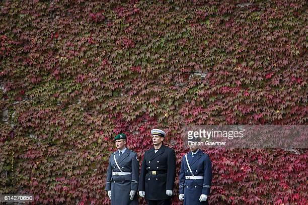 Soldiers of the guard batallion wait for the military honours in front of the Federal Chancellery on October 12 2016 in Berlin Germany