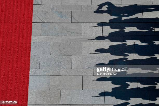 Soldiers of the honour guard cast a shadow before the arrival of French Prime Minister Edouard Philippe at the Chancellery in Berlin on September 15...