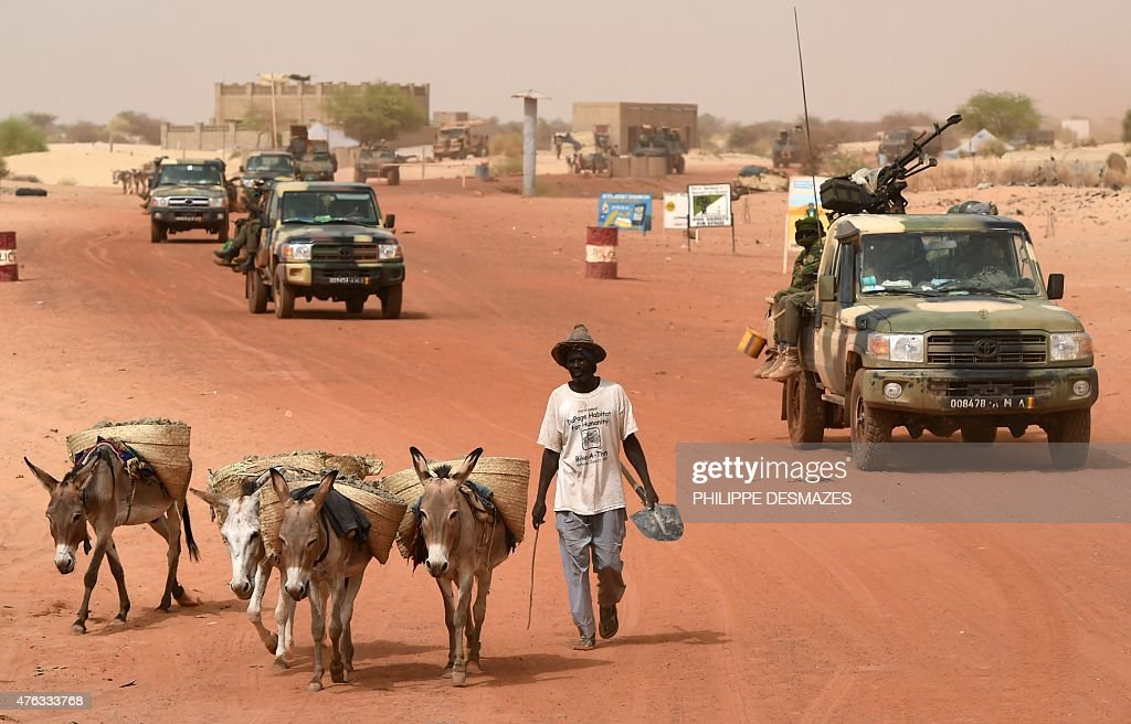 Soldiers of the Malian Armed Forces and French soldiers of the 93rd Mountain Artillery Regiment patrol on June 6 2015 in Timbuktu during the joint...