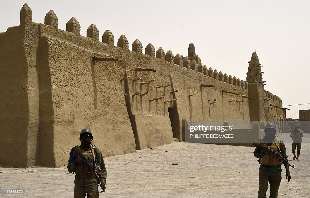 Soldiers of the Malian Armed Forces patrol next to the Djingareyber Mosque on June 6 2015 in Timbuktu during the joint operation 'La Madine 3' part...