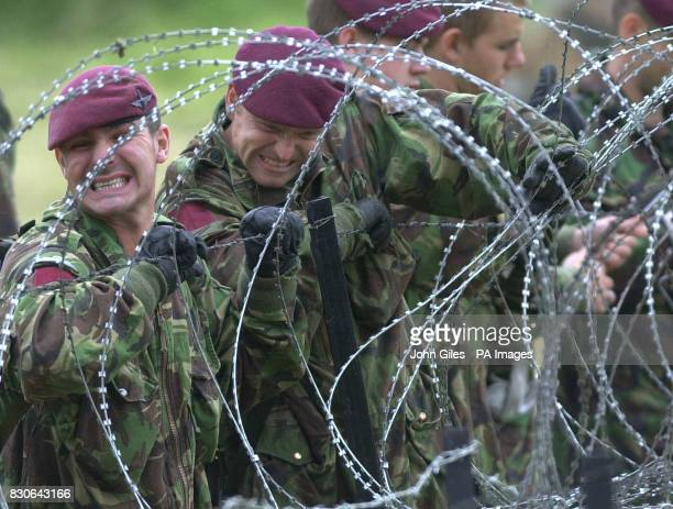 Soldiers of the Parachute Regiment put razor wire barriers into position around the RUC Lines at Drumcree Church ahead of the controversial and...