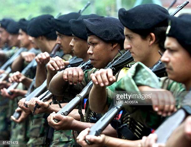 Soldiers of the Revolutionary Armed Forces of Colombia take part in a military parade in San Vicente del Caguan Caqueta Colombia 07 February 2001...