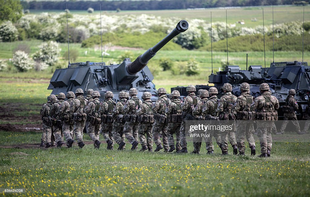 Soldiers of the Royal Artillery take part in the Artillery's 300th anniversary celebrations at Knighton Down on May 26, 2016 in Lark Hill, England. Queen Eliabeth II has been Captain-General of the Royal Regiment of Artillery since 6 February 1952.
